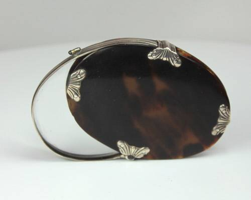 A Tortoiseshell and silver magnifying glass