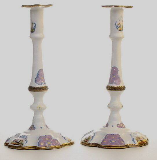 A Pair of English enamel candlesticks