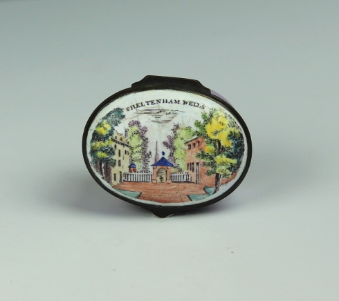 "A Bilston Enamel Patch Box ""Cheltenham Wells"" with an original inside mirror"