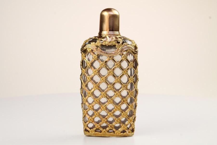 A very Fine and large gold cage work bottle