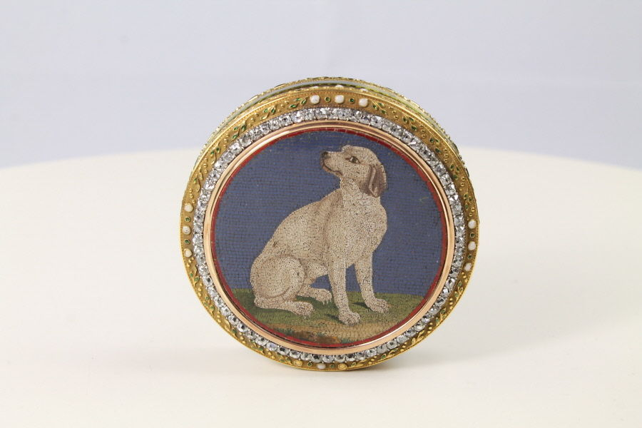 A micro mosaic with a scene of seated dog