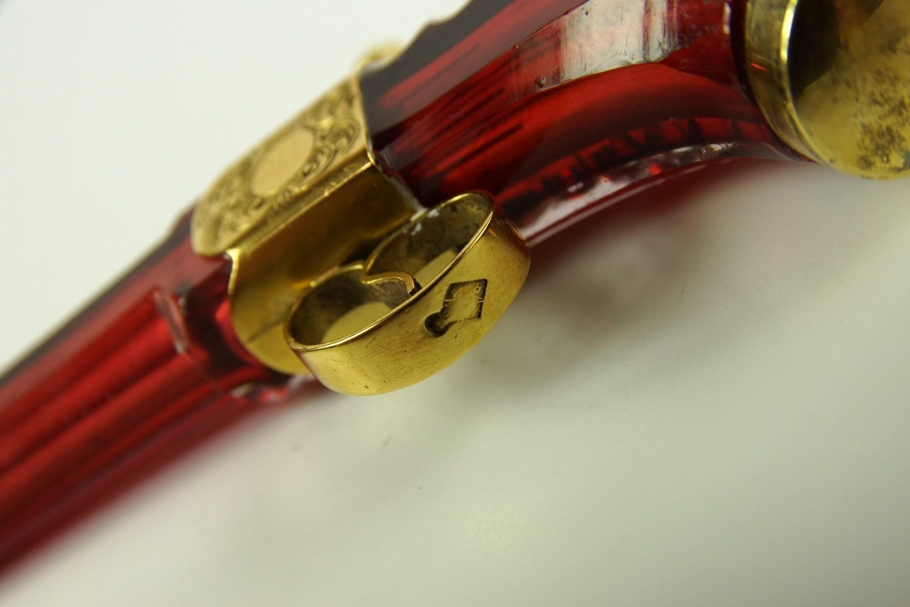 A fine cranberry glass gun shaped perfume bottle - The