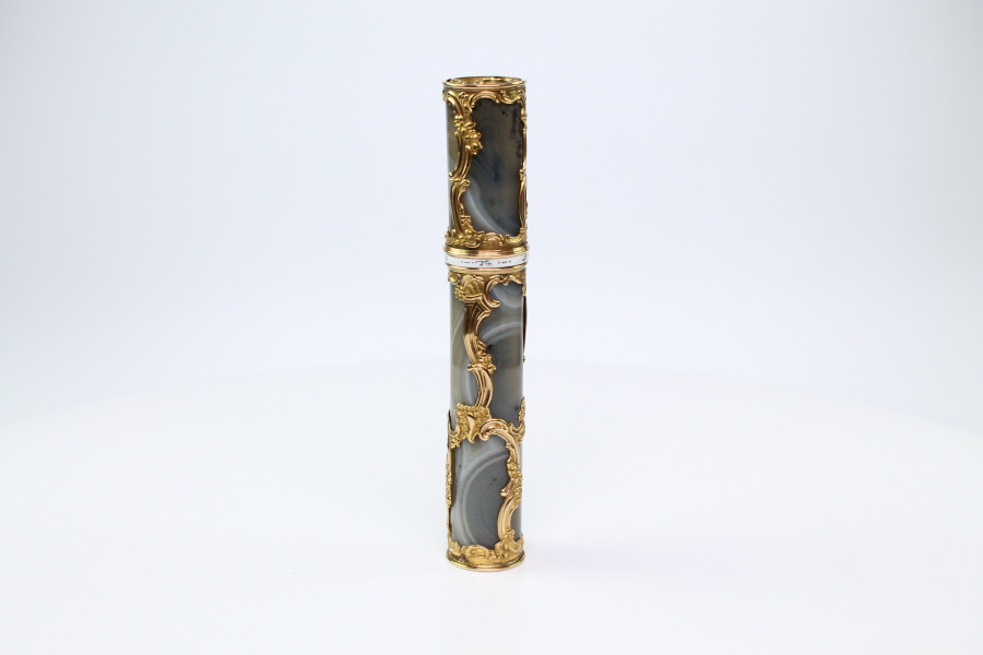 A banded grey agate and Gold  cage work  bodkin case with gold mounts